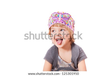 Small girl showing tongue isolated on white background