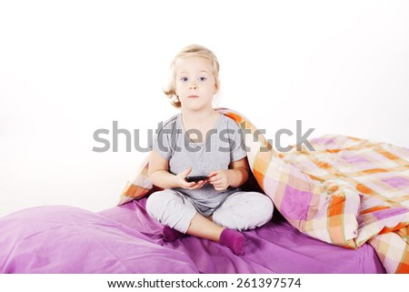 Small girl text message on the mobile - stock photo
