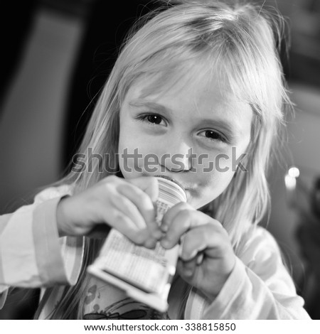 small girl with chocolate - stock photo