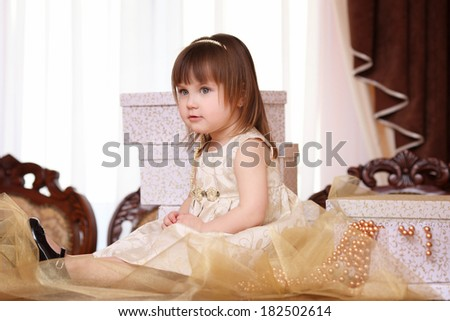 Small girl with gift boxes
