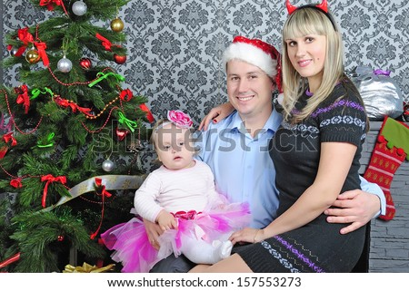 Small girl with parent near fir trees