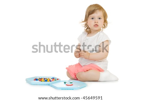 Small girl with toy mosaic isolated on white
