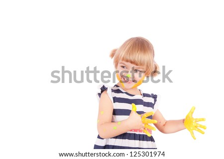 Small girl with yellow paint on her palms isolated on white - stock photo