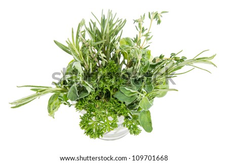 Small glass filled with different Herbs isolated on white background