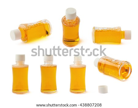 Small glass vial bottle filled with the yellow liquid isolated over the white background, set of multiple different foreshortenings - stock photo