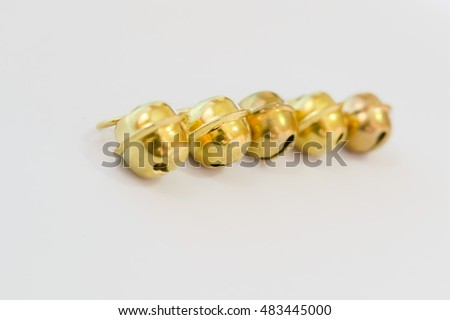 Bells and whistles stock images royalty free images for Small gold christmas ornaments