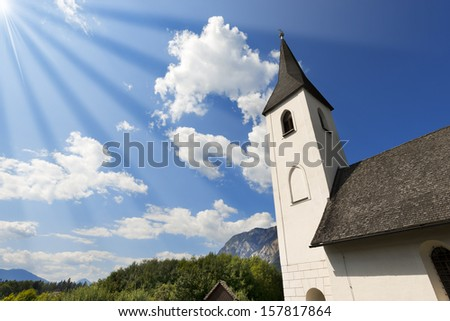 Small Gothic Church - Austria / Catholic Church in Gothic style dedicated to St. Mary Magdalene and Cemetery in the small village of Obersch�¼tt in Carinthia - Austria - stock photo
