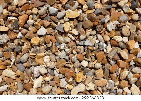 Small gravel stones as an abstract background texture - stock photo