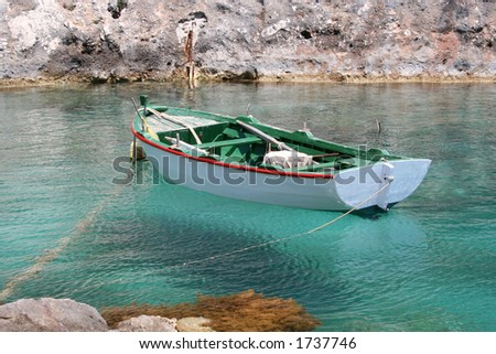 Small Greek fishing boat moored at Porto Vromi, Zante (Zakynthos) - stock photo