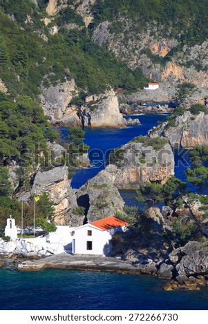 Small Greek island with white church on the Ioanian sea shore, Parga, Greece - stock photo