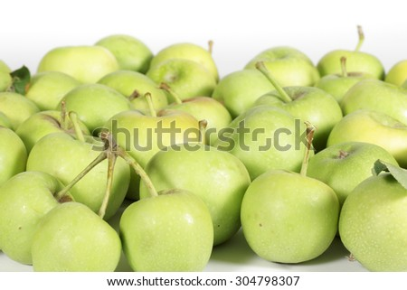 Small green apples on white
