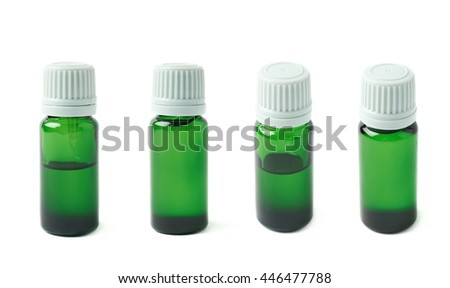 Small green glass flask vial, composition isolated over the white background, set of four different foreshortenings - stock photo