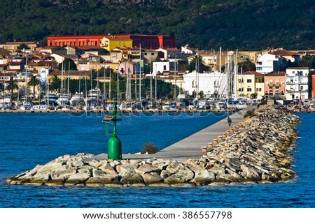 Small green lighthouse at entrance to Carloforte harbor at San Pietro island, Sardinia, Italy