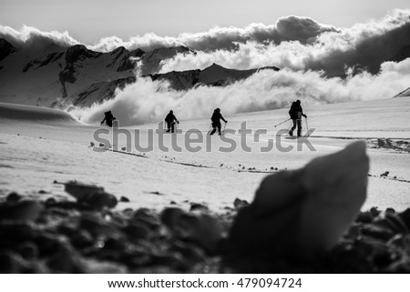 Small group ascending the glacier with ski