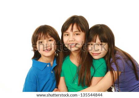 small group of asian children hugging with copy space - stock photo