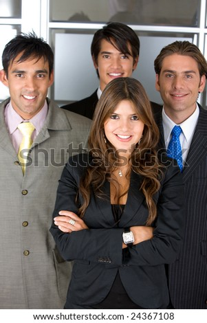 Small group of business people in an office smiling