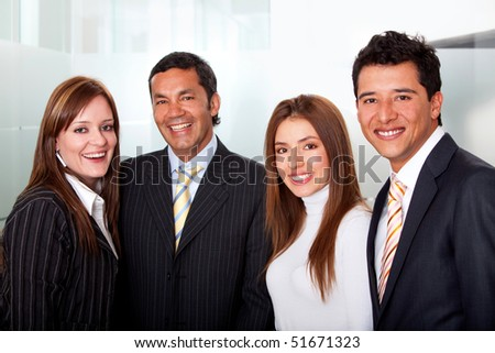 Small group of business people smiling at the office