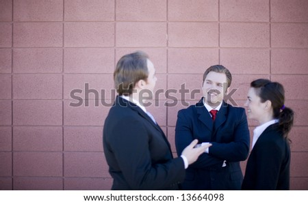small group of businesspeople in circle standing discussing - stock photo