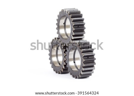Small group of gears with their teeth engaged on a white background.