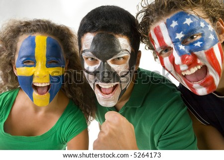 Small group of happy international soccer fans. they're looking at camera. Front view. Closeup on faces. - stock photo