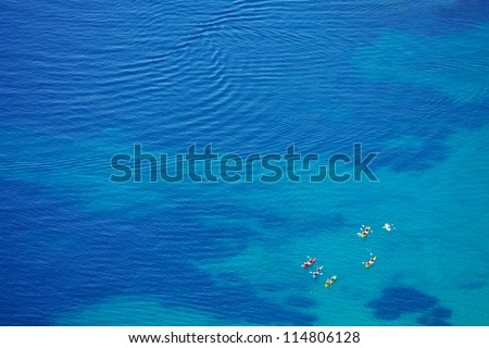 small group of kayaks in crystal clear Adriatic waters - stock photo