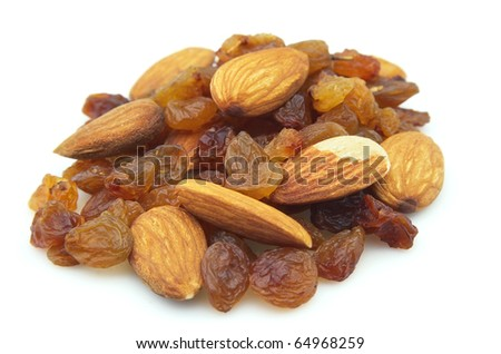 Small group of raisin with almonds on a white background