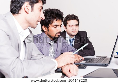 small group of young businessmen in office meeting - stock photo