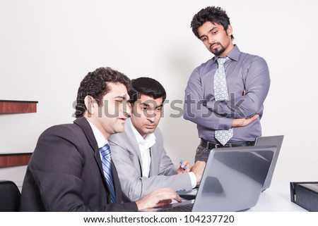 small group of young multiracial businessmen in office meeting - stock photo