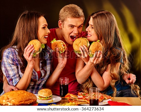 Small group people holding hamburgers and drinks cola .  - stock photo