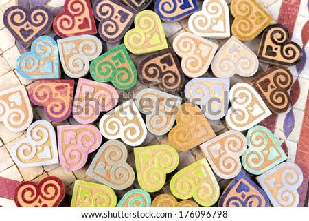 Small handmade clay hearts, Morocco - stock photo