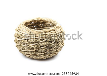 Small handmade wicker basket on white background