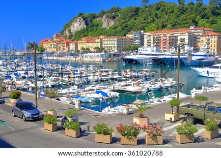 Small harbor populated with leisure boats in Nice, French Riviera, France - stock photo