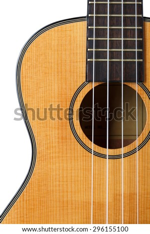 Small Hawaiian four stringed ukulele guitar isolated on white background with clipping path. Musical instruments shop or learning school concept - stock photo