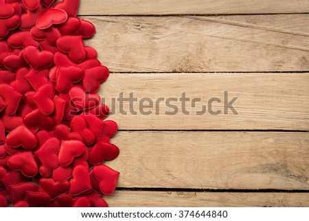 Small heart on brown wooden for Valentine background