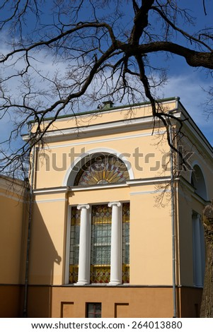 Small historical house and bare tree in Gomel - stock photo