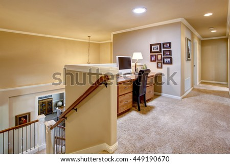 Small home office area in the hallway with carpet floor. View to downstairs
