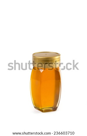 Small honey jar with cover isolated on a white background - stock photo