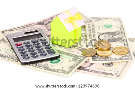 Small house and money isolated on white - stock photo