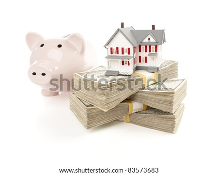 Small House and Piggy Bank with Stacks of Hundred Dollar Bills Isolated on a White Background. - stock photo