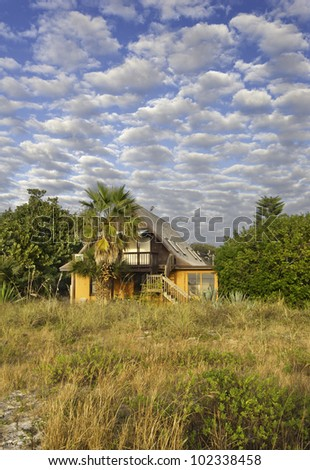 Small House By the Sea A Colorful small house on a Florida beach. - stock photo