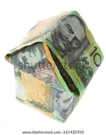 Small house made of Australian Money - Aussie currency - stock photo