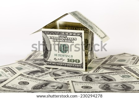 Small house made ??of dollar bills - stock photo