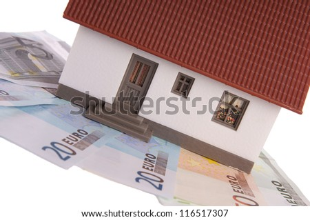 small house with banknotes / dream of own house