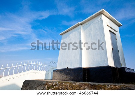 small house with blue sky - stock photo
