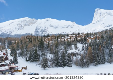 Small houses at the base of the mountain in the Devoluy mountains, part of the Dauphine Prealps, France - stock photo