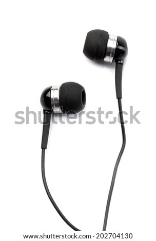 Small in-ear headphones isolated on white background - stock photo