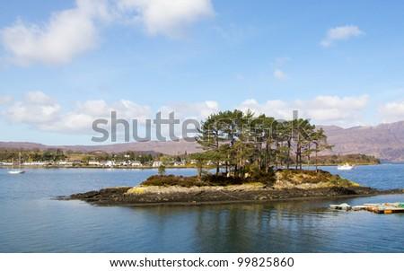 Small island in Loch Carron towards Plockton - stock photo