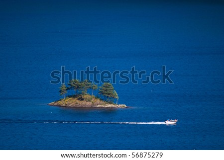 Small island in the big lake - stock photo