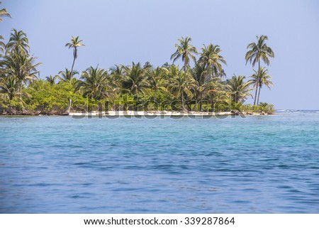 small Island in the deep blue caribbean sea in the area of San Blas Islands, Panama