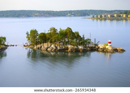 Small island with lighthouse, Sweden - stock photo